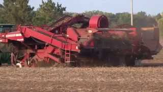 Spudnik 6400 Potato Harvester pulled by Deere 8285R