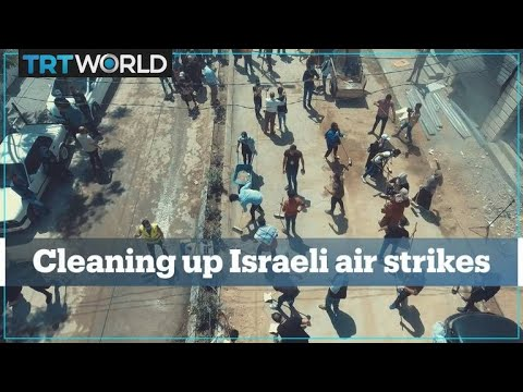 Palestinians clean up the streets of Gaza