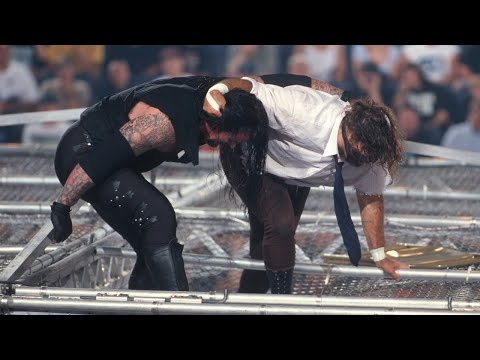 The Undertaker throws Mankind off the top of the Hell in a C