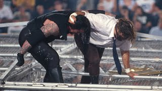 The Undertaker throws Mankind off the top of the Hell in a Cell