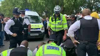 TOMMY ROBINSON SUPPORTER ISABELLA ATTACKS POLICE OFFICER : SPEAKERS CORNER