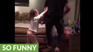 Toddler gets knocked over playing basketball with dad!
