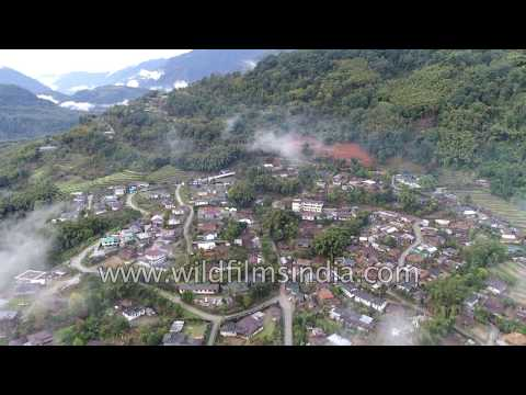 Township in the rain-forest: aerial view of Siang river bank town of Yingkiong in Arunachal