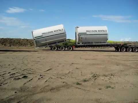 Alberta Oilfield - Unloading 400 Barrel Tanks
