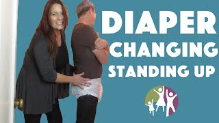Adult Autistic Child: Changing Diapers in a Standing Position