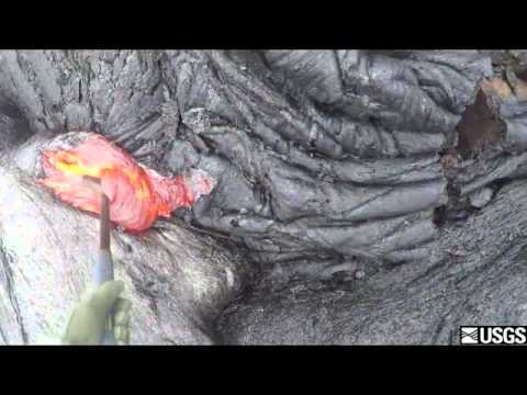 This is how a geologist collects lava samples from a volcano