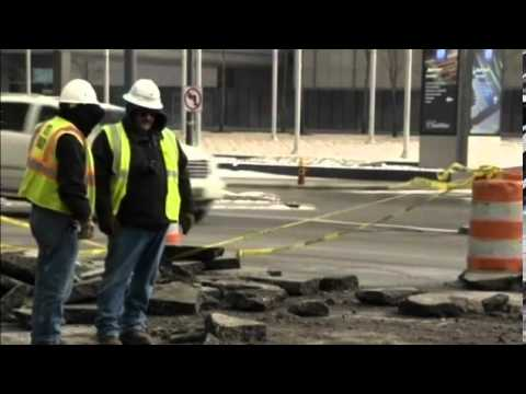 Massive sinkhole collapses street in Detroit