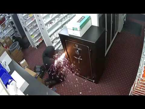 Surveillance video of a break-in robbery.