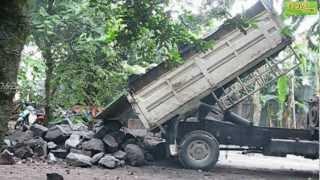 Stone Stuck in Dump Truck Unloading