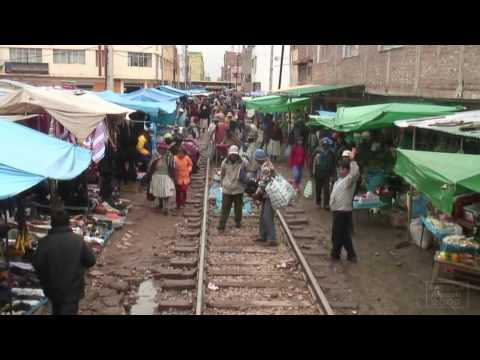 "Peru Rail ""Andean Explorer"" going through Juliaca's market"