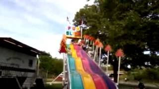 Bubs and kids going down fun slide at carnival