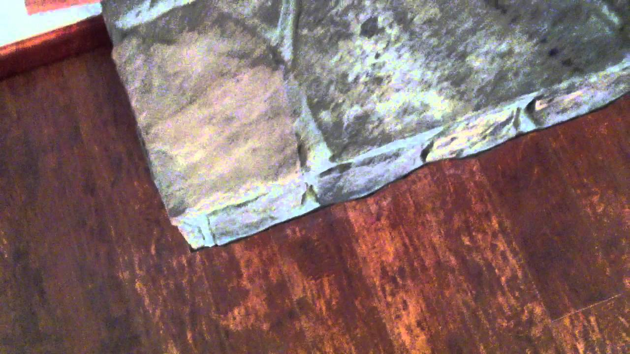 how to cut laminate flooring next to a stone fireplace youtube