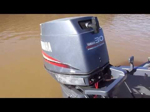 how to start an outboard motor after storage