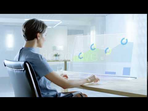 In the Near Future Renewable Energy Scientist Works with Transparent Computer. | Stock Footage -
