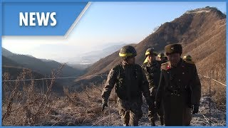 North Korean troops cross the border for guard post inspections