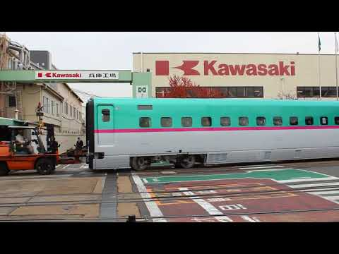 A Shinkansen car being moved in the factory of Kawasaki Heavy Industry