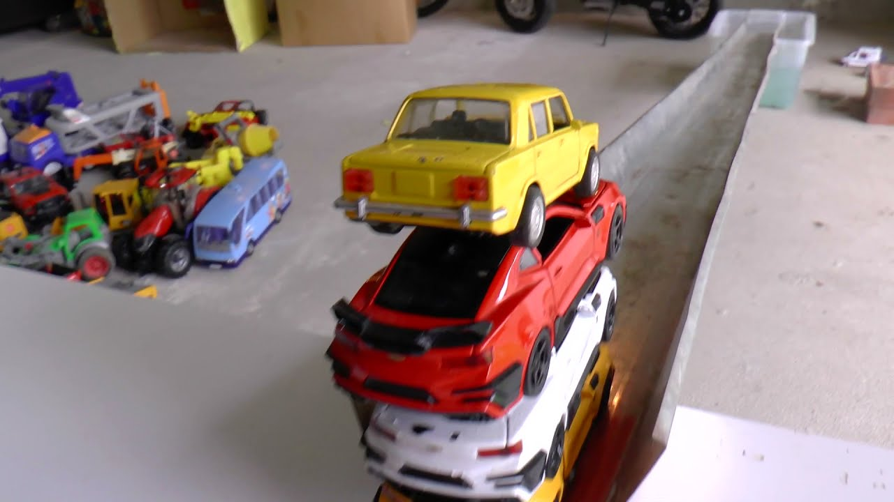 Die cast cars from the flowers go down the hill into the water