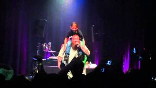 Action Bronson rapping with little girl on shoulders
