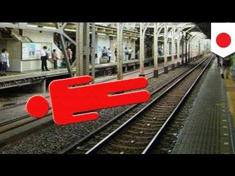 Train runs over Japanese office worker but no one notices