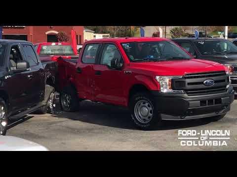 CAR CRASHES HARD INTO FORD DEALERSHIP!