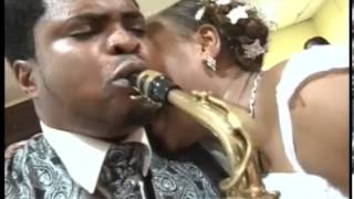 JERRY OMOLE plays the sax for his QUEEN