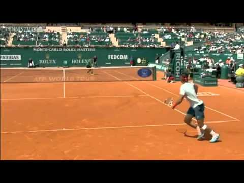 Matosevic knocks over Nadal's water bottles. (2013 Monte Carlo)