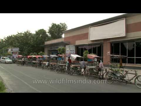 Rickshaw pullers waiting for commuters outside Vishwavidyalaya metro station