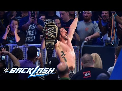 AJ Styles raises his hands high as the new WWE World Champion: Backlash 2016