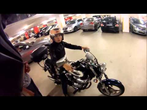 Poor Lady's Motorcycle Dropped from Broken Stand
