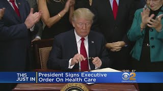 2017-10-12-17-38.Trump-Signs-Health-Care-Executive-Order