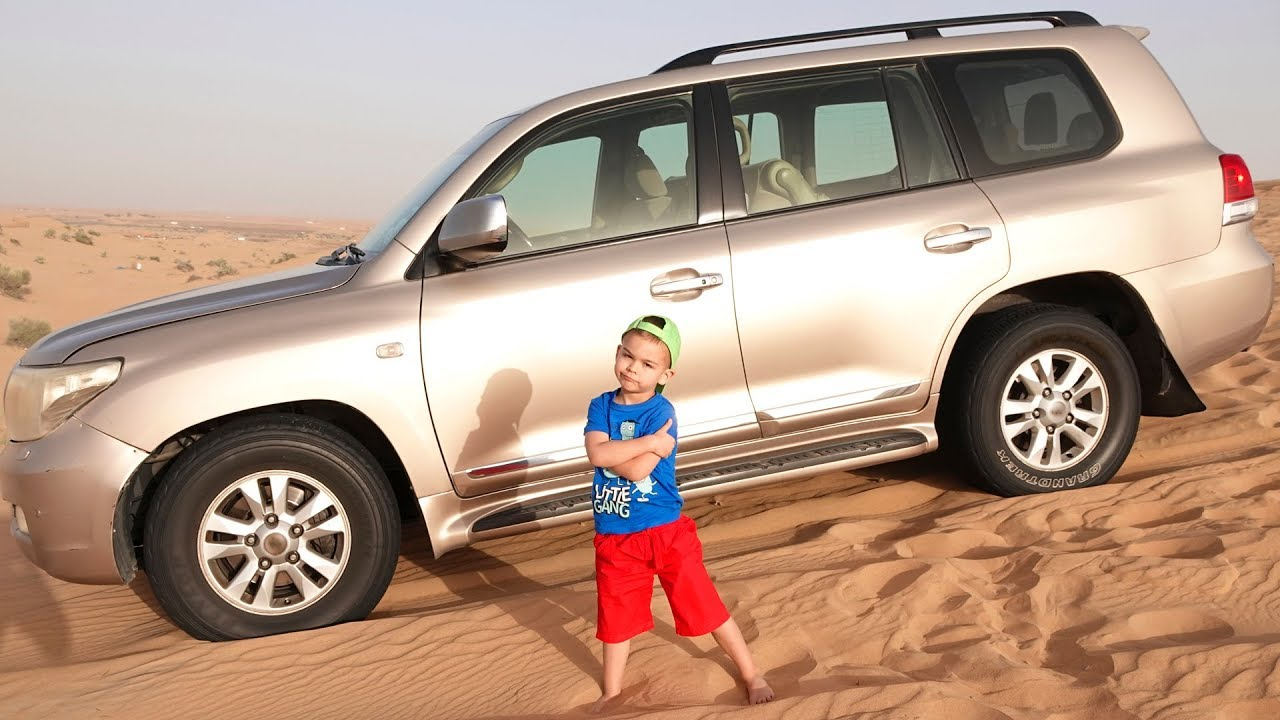 Dima on the Dubai desert safari ride on big car
