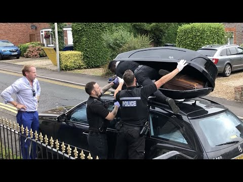 Moment migrant discovered in car box as couple return from France