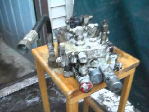 463 Bobcat skid steer hydraulic  spools removal - YouTube