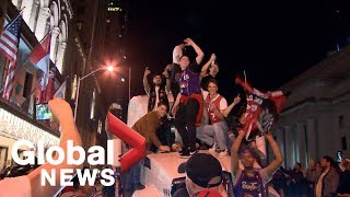 Toronto Raptors fans set off fireworks, climb on truck as Game…