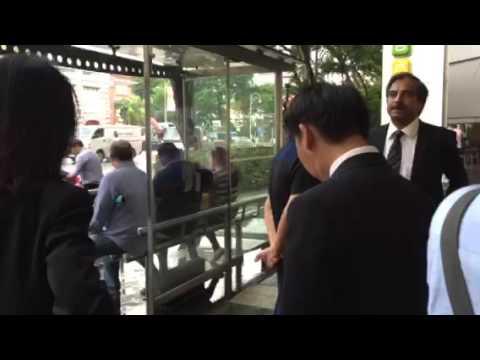 Dan Tan waiting at a taxi stand