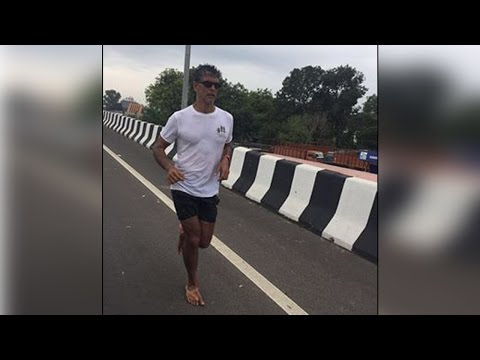 Milind Soman running barefoot from Ahmedabad to Mumbai, Know why| Oneindia News