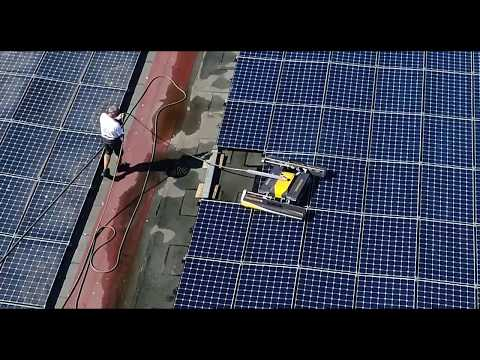 VOLTANET - CLEANING SOLAR PANELS WITH ROBOT ON FLAT ROOF, FILMED BY DRONE