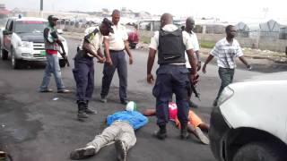 #haiti vyolans4 arestasyon fet nan afrontman bandi ak lapolis nan zon aviyasyon