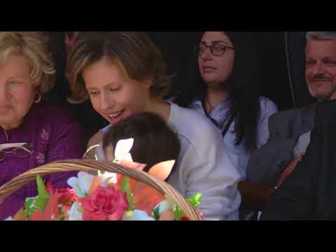 Syria's first lady Asma al Assad visits school in Homs