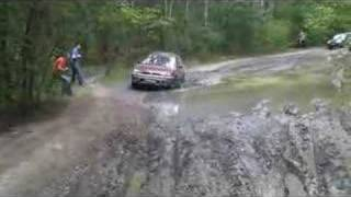 Subaru Outback in deep mud