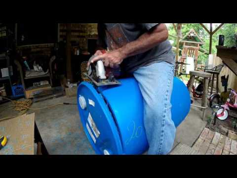 The easiest and quickest way to cut the lid off of a plastic barrel