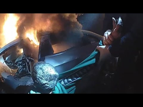 video: Watch the dramatic moment police rescue man from burning car