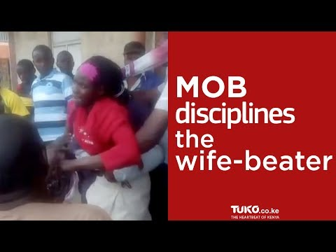 Mob disciplines a wife beater