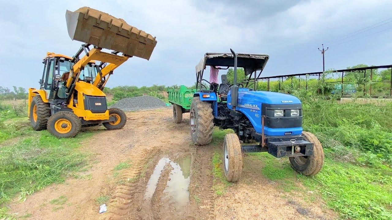 Sonalika 60 Rx with Trolley Loading Sand using JCB 3dx Eco