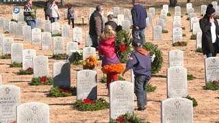 Thousands of volunteers lay wreaths at DFW National Cemetery thumbnail
