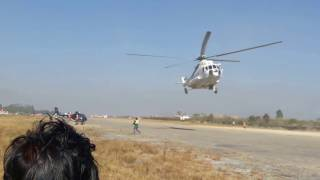 Helicopter rescue by another helicopter in Nepal