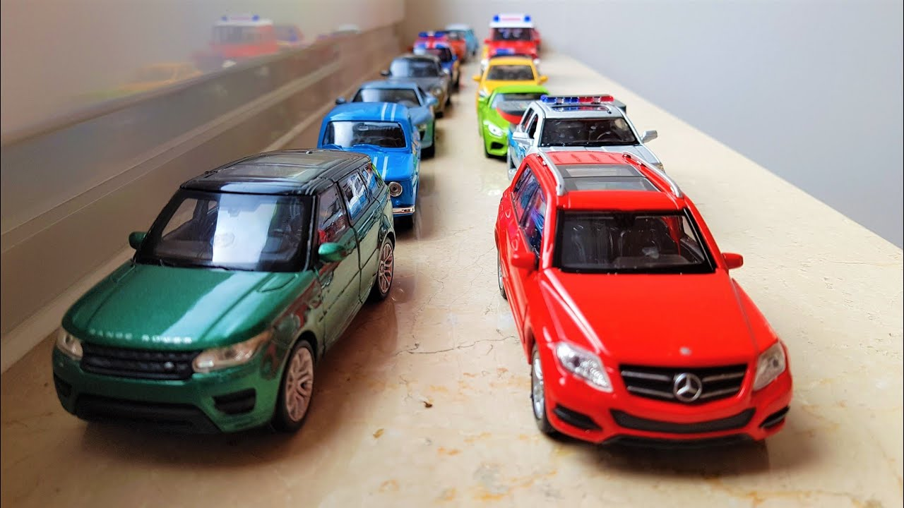 Showing various cars on a windowsill