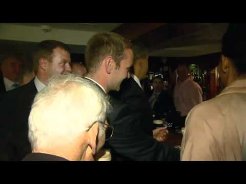 Slainte! Barack Obama toasts Irish ancestors with a Guinness