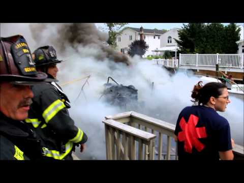 40 - 50 foot boat fire in Oceanside, New York