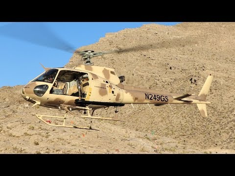 Shooting Machine gun out of helicopter